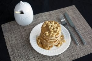 Elvis Presley Pancakes - large stack of golder pancakes with fried panacakes
